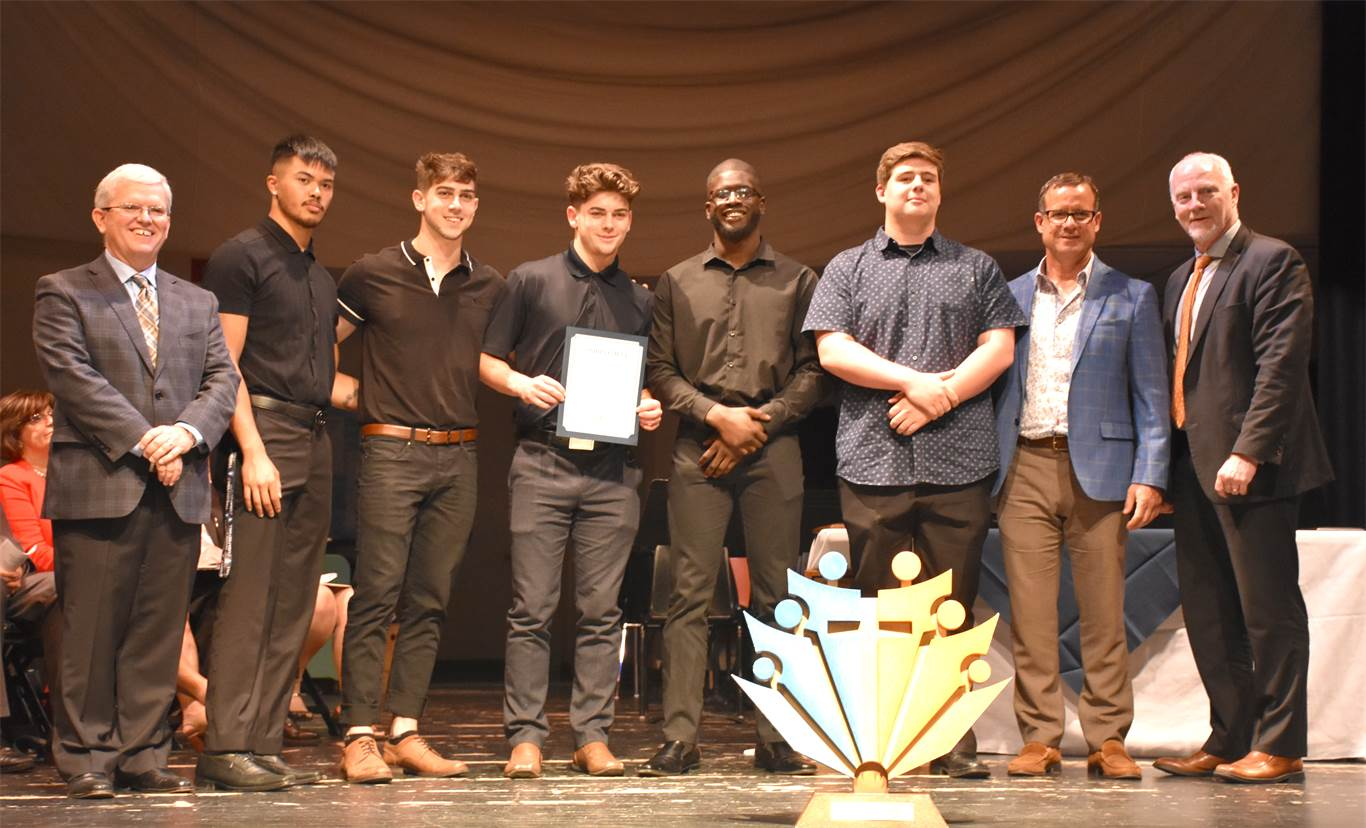 The St. Thomas More Catholic Secondary School Senior Boys' Football Team was recognized for repeating as OFSAA Western Bowl Champions.