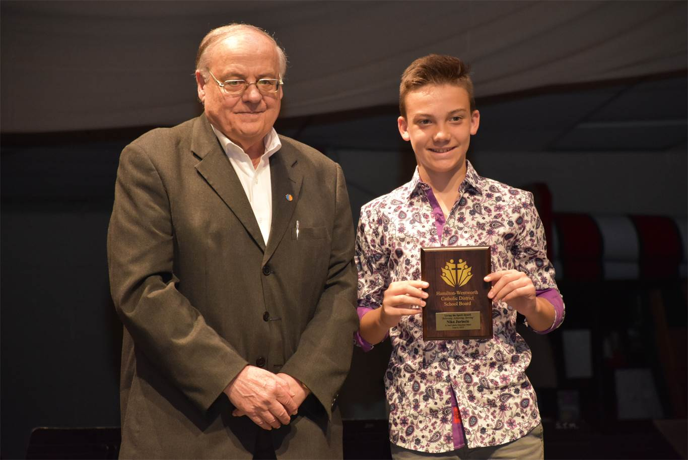 Trustee Louis Agro presents Niko Jurincic from St. Paul with a Living the Spirit Award. The award is presented to a graduating student from each elementary and secondary school who exemplifies the qualities of the Board's logo, 'Believing, Achieving, Serving.'